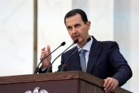 Syria's President Bashar al-Assad is accused of a wide range of war crimes and crimes against humanity. Photograph: Sana/AFP/Getty Images