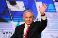 Israeli Prime Minister Benjamin Netanyahu waves to his supporters at his Likud party's headquarters in Jerusalem on Wednesday. (Ariel Schalit/AP)