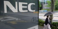 The logo of Japan's electronics and information technology company NEC displayed at the company's headquarters in Tokyo, on 27 June 2020. Photo by KAZUHIRO NOGI/AFP via Getty Images.