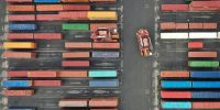 An aerial photo shows Straddle Carriers moving shipping containers at Seaforth Dock in Liverpool, north west England on 17 March 2021. Photo by PAUL ELLIS/AFP via Getty Images.