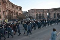 Armenians, flanked by police officers, take part in a protest to demand the resignation of Prime Minister Nikol Pashinyan in Yerevan, Armenia, on March 6. (Karen Minasyan/AFP/Getty Images)