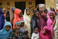 Women lined up to cast their votes on Feb. 23, 2019, in the village of Tumfafi, near Kano, in northern Nigeria. (Ben Curtis/AP)