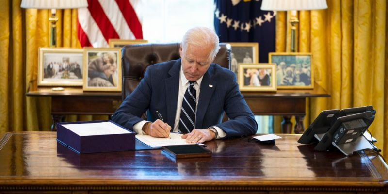 US President, Joe Biden, signs the American Rescue Plan into law on 11 March 2021 at the Oval Office. Photo: Getty Images.