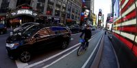 Cars and cyclists in Times Square in New York. More than 300 corporates are pushing the Biden administration to almost double the US' target for cutting its greenhouse gas emissions in 2021. Photo: Getty Images.
