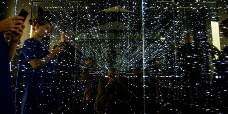 Reproducing the atmosphere of a large data centre using an infinity chamber at the Futurium in Berlin, a space for dialogue between governments, technology scientists, industry, and society. Photo by JOHN MACDOUGALL/AFP via Getty Images.