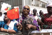 A Senegal resident welcomes Chinese President Xi Jinping during his visit to Dakar, Senegal, in July 2018. (Xaume Olleros/AP)