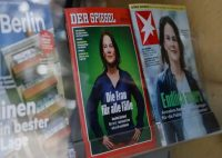 Copies of magazines Der Spiegel and Stern feature Annalena Baerbock, the Greens' chancellor candidate for the general election in September, at a shop in Berlin on Tuesday. (David Gannon/AFP/Getty Images)