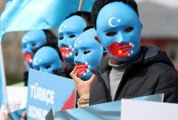 Uyghur protesters hold signs during a demonstration against China in Istanbul on Thursday. (Tolga Bozoglu/EPA-EFE/REX/Shutterstock)