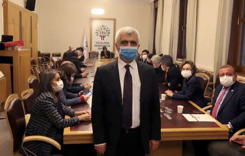 Omer Faruk Gergerlioglu, a human rights advocate and lawmaker from Turkey's People's Democratic Party, in Ankara, Turkey, on March 17, with colleagues. (AP)