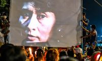 An image of Myanmar's detained leader Aung San Suu Kyi is projected on to a screen during a night-time demonstration in Yangon in March. Photograph: AFP/Getty Images