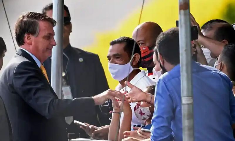 'Brazil's president Jair Bolsonaro has frequently appeared in public places without a mask, stopping to greet supporters.' Photograph: Evaristo Sa/AFP/Getty Images