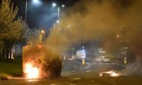 Police attend the scene at Cloughfern roundabout, Newtownabbey, as loyalist protesters hijack and burn vehicles on 4 April 2021. Photograph: Charles McQuillan/Getty Images