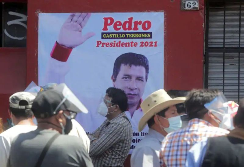 Supporters of Peru's presidential candidate Pedro Castillo stand in front of the party headquarters in Lima on April 20. (Sebastian Castaneda/Reuters)