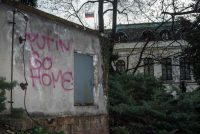 """""""Putin go home"""" is seen on a wall near the Russian embassy in Prague on Thursday. (Michal Cizek/AFP/Getty Images)"""