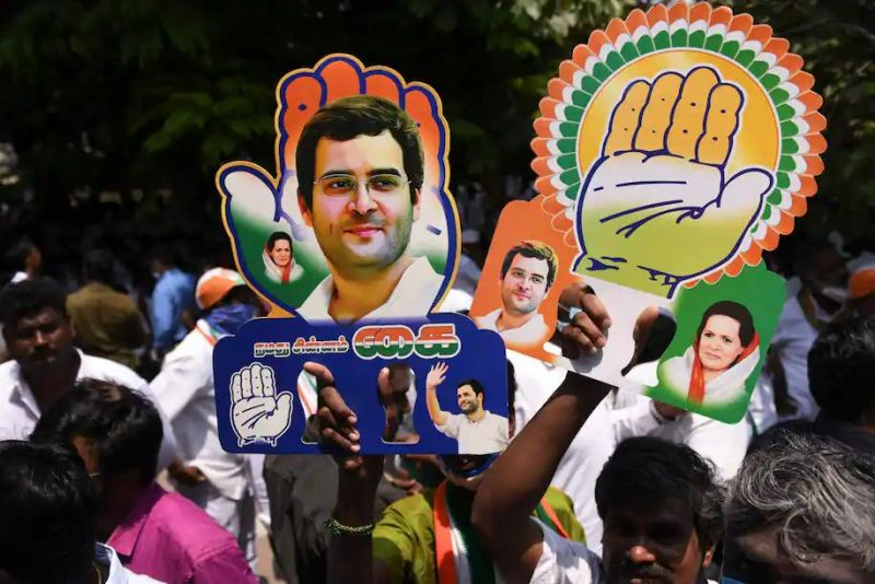 Congress party supporters hold placards with the face of Rahul Gandhi during a rally in Chennai, India on March 28. (Arun Sankar/AFP/Getty Images)