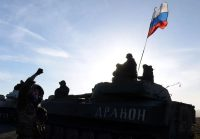 A Russian flag flies near a convoy of pro-Russian forces moving from the front line near the eastern Ukrainian city of Starobeshevo in Donetsk region in February 2015. (Vasily Maximov/AFP/Getty Images)