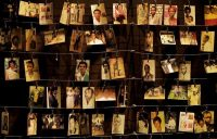 Family photographs of some of those who died during the 1994 genocide hang on display in an exhibition at the Kigali Genocide Memorial center in Rwanda's capital in April 2019. (Ben Curtis/AP)