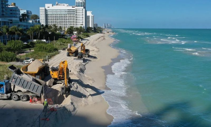 The US army corps of engineers distributes sand along the beach in Miami Beach, Florida. The project is part of a $16m scheme to widen the beaches in an effort to fight erosion and protect properties from storm surges. Photograph: Joe Raedle/Getty Images
