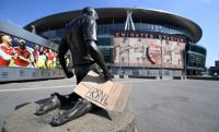 """A sign reads """"Give us our Arsenal back"""" outside Arsenal's Emirates Stadium in London on April 20. (Andy Rain/EPA-EFE/REX/Shutterstock)"""