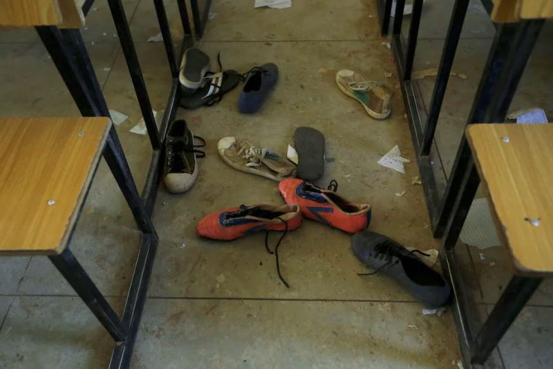 Shoes are left behind in a school in Kankara, Nigeria, where Boko Haram claimed to have abducted hundreds of students in December 2020. (Sunday Alamba/AP)