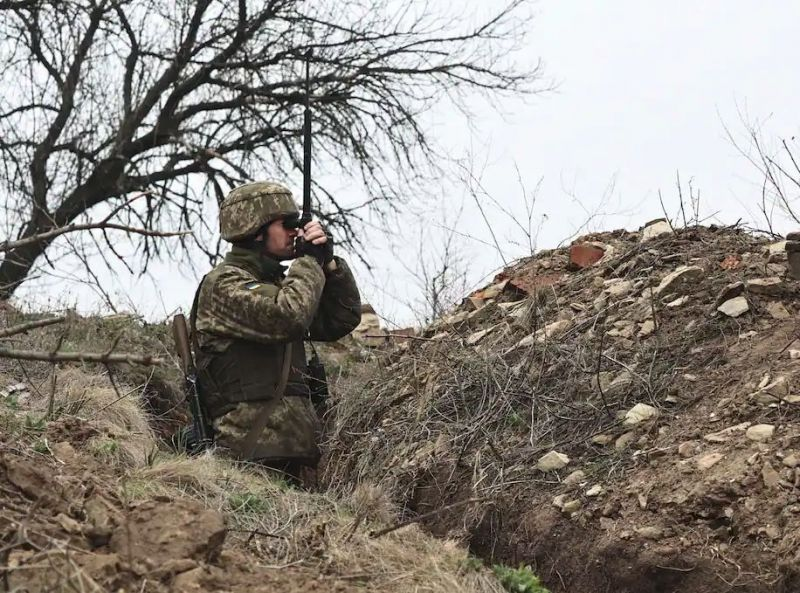 A Ukrainian soldier stands near the line of separation from pro-Russian rebels near Donetsk, Ukraine, on Monday. (AP)