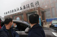 Members of the World Health Organization team investigating the origins of covid-19 arrive at the Wuhan Institute of Virology in Hubei province, China, on Feb. 3. (Hector Retamal/AFP via Getty Images)