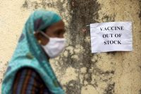 A notice about a shortage of covid vaccines is seen at a vaccination center in Mumbai, India, on Thursday. (Francis Mascarenhas/Reuters)