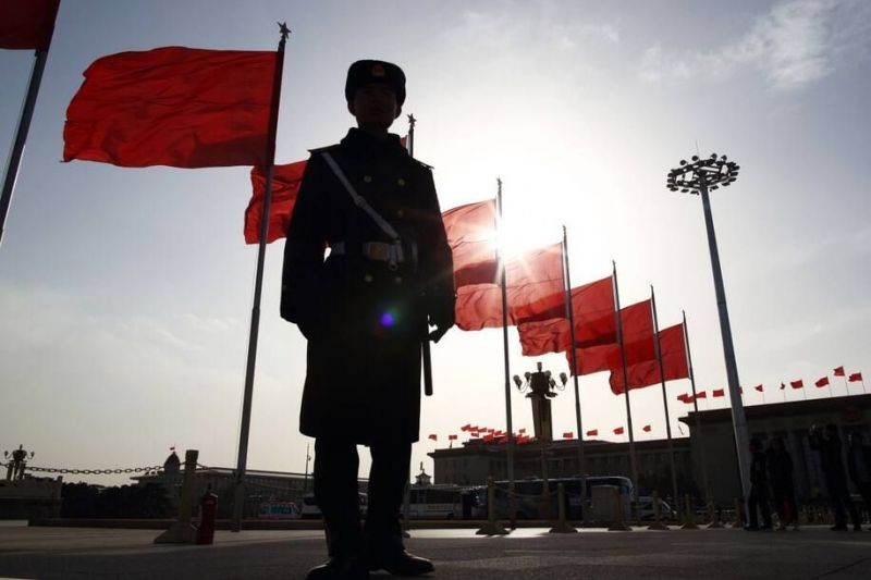 A paramilitary police officer in Tiananmen Square in Beijing. (Tomohiro Ohsumi/Bloomberg News)