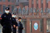Security personnel keep watch outside the Wuhan Institute of Virology in Wuhan, China, on Feb. 3. (Thomas Peter/Reuters)