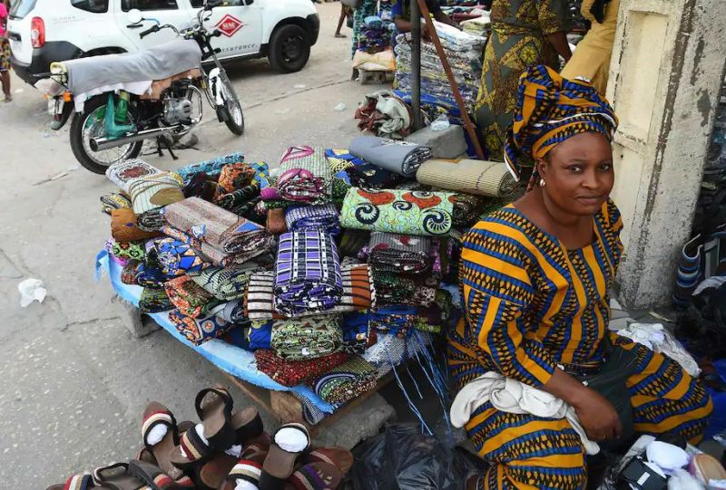 A vendor displays her wares along a road in Cotonou on April 14, as business resumes after incumbent Patrice Talon was declared the winner of Benin's presidential election. (Pius Utomi Ekpei/AFP/Getty Images)