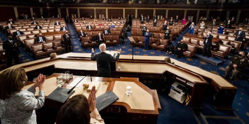 President Joe Biden addresses a Joint Session of Congress, with Speaker of the House Nancy Pelosi and Vice President Kamala Harris behind on the dais. Photo by Melina Mara - Pool/Getty Images.