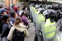 Protesters and police face off in Bogota, Colombia, on Tuesday. (Carlos Ortega/EPA-EFE/Shutterstock)