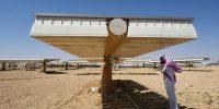 Under the shade of a solar panel at a plant in Uyayna, north of Riyadh, Saudi Arabia. Photo by FAYEZ NURELDINE/AFP via Getty Images.