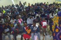 Congolese refugees sit in a stadium in Rwanda after fleeing from Mount Nyiragongo volcano as it erupted over Goma, Rwanda, on Sunday. (Eugene Uwimana/EPA-EFE/REX/Shutterstock)