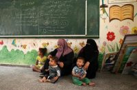 Palestinian families take shelter at a United Nations school in the southern Gaza Strip on Tuesday. (Said Khatib/AFP/Getty Images)