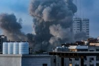 Smoke rising after Israeli airstrikes in Gaza City on Tuesday. Credit Mohammed Saber/EPA, via Shutterstock