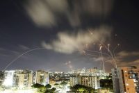 Streaks of light are seen as Israel's Iron Dome antimissile system intercepts rockets launched from the Gaza Strip toward Israel, as seen Wednesday from Ashkelon, Israel. (Amir Cohen/Reuters)