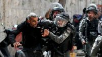 Israeli police detain a Palestinian man during clashes at the compound that houses the al-Aqsa Mosque in Jerusalem on Monday. (AMMAR AWAD/REUTERS)
