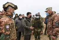 Ukraine President Volodymyr Zelensky speaks with servicemen during a visit to army outposts on the administrative border with Russia-annexed Crimea. (Handout/Ukrainian Presidential Press Ser)