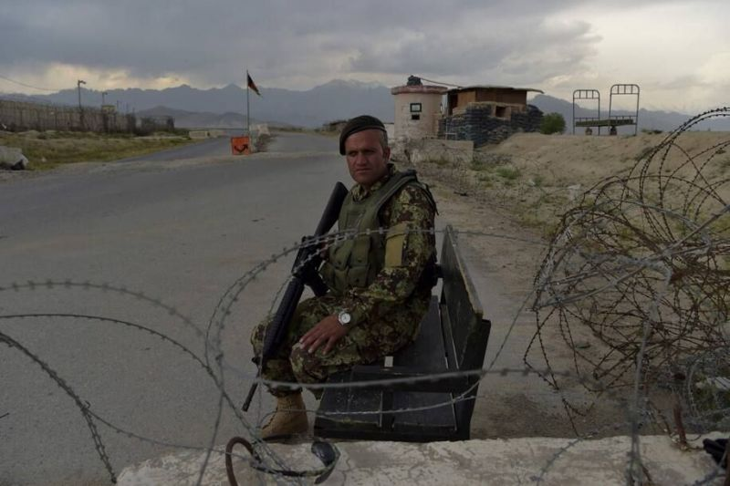 An Afghan soldier at a road checkpoint near a U.S. military base in Bagram on Thursday. (Wakil Kohsar/AFP/Getty Images)