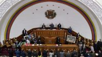 The president of the National Assembly, Jorge Rodriguez (C-top) swears in the new authorities of the National Electoral Council (CNE), during a special session at the National Assembly, in Caracas. 4 May 2021. Federico PARRA / AFP
