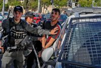 Israeli security forces detain a Palestinian man outside the Damascus Gate in Jerusalem's Old City on Thursday. (Ahmad Gharabli/AFP/Getty Images)