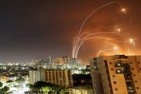 Israel's Iron Dome antimissile system intercepts rockets from the Gaza Strip, as seen from Ashkelon, Israel, on May 12. (Amir Cohen/Reuters)