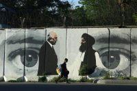 A mural in Kabul, Afghanistan, depicting Washington's peace envoy Zalmay Khalilzad, left, and Mullah Abdul Ghani Baradar, the leader of the Taliban delegation. Credit Rahmat Gul/Associated Press