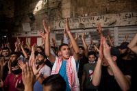 Palestinians protesting at Damascus Gate in Jerusalem's Old City on Monday. Credit Amir Levy/Getty Images