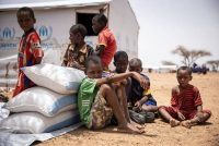 Children sit by their shelter in Goudebo, a camp with more than 11,000 Malian refugees in northern Burkina Faso, on International Refugee Day on June 20. (Olympia De Maismont/AFP/Getty Images)