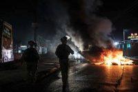 Israeli police patrol as Arabs, police and Jews fight in Lod, Israel, on May 12. (Heidi Levine/AP)