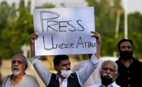Pakistani journalists and members of civil society take part in a demonstration to condemn attacks on journalists, in Islamabad, Pakistan, on May 28. (Anjum Naveed/AP)