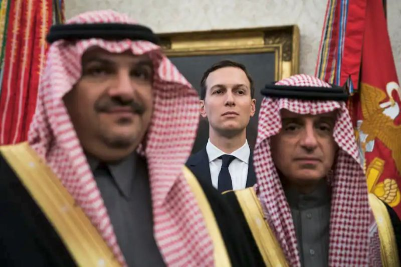 White House senior adviser Jared Kushner stands among Saudi officials as President Donald Trump talks with Saudi Crown Prince Mohammad bin Salman during a meeting in the Oval Office at the White House in March 2018. (Jabin Botsford/The Washington Post)