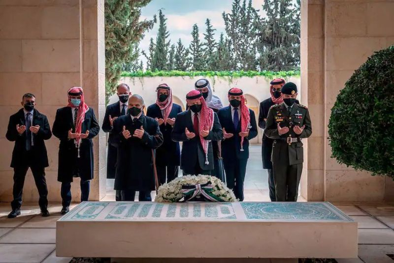 This photo from the Royal Court Twitter account shows Jordan's King Abdullah II, center, Prince Hamzah, second from left, and others during a visit to the tomb of the late King Hussein, in Amman in April. (AP)